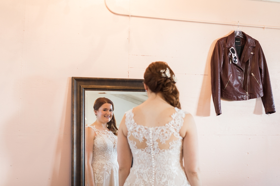 Photo of bride looking in mirror at Snohomish Wedding Venue Dairyland Barn near Seattle | Joanna Monger Photography