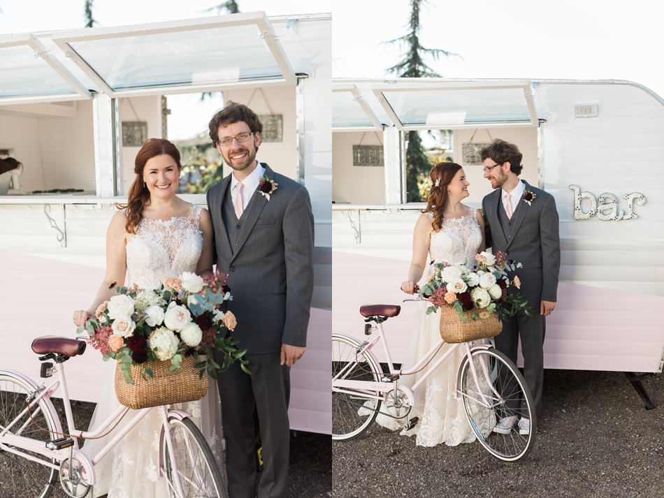 Photo of couple and vintage trailer and bikes at Snohomish Wedding Venue Dairyland Barn near Seattle | Joanna Monger Photography