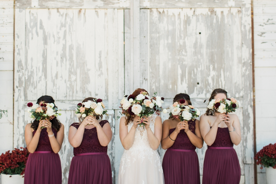 Photo of bridal party in front of white-wash barn at Snohomish Wedding Venue Dairyland Barn near Seattle | Joanna Monger Photography