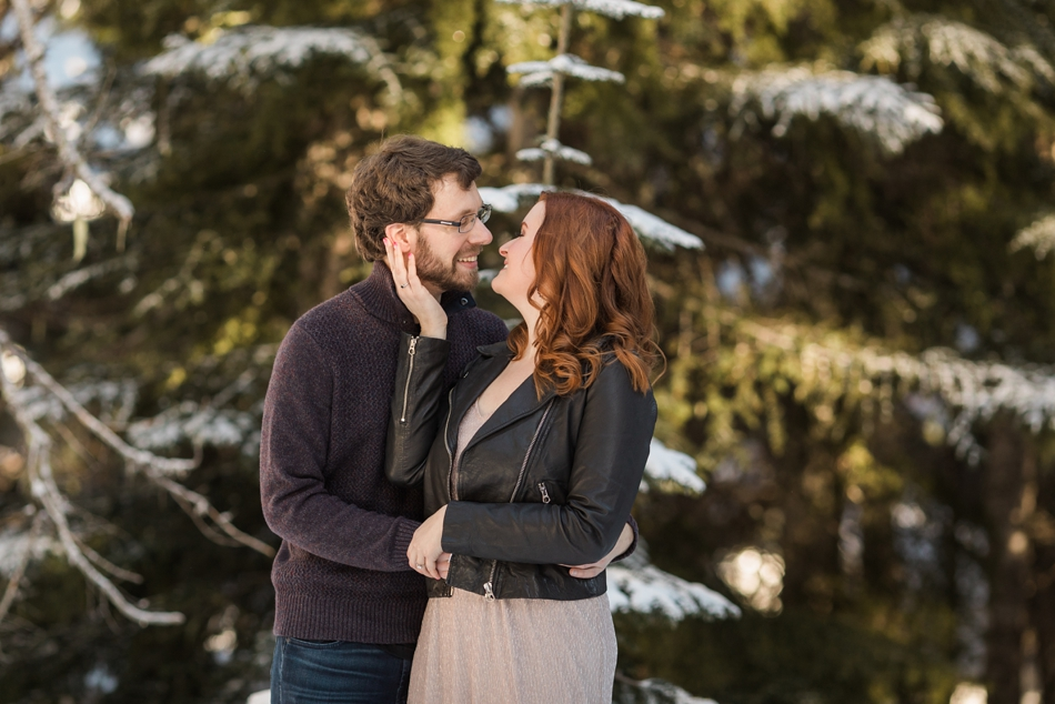 An engaged couple embraces in the snow during their Steven's Pass engagement shoot for their dreamy DIY wedding at Dairyland in Snohomish, a wedding venue near Seattle. | Joanna Monger Photography | Snohomish & Seattle Photographer