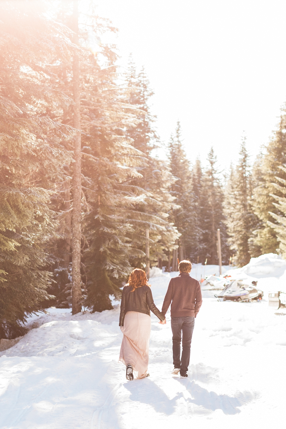 An engaged couple holds hands in the snow during their Steven's Pass engagement shoot for their dreamy DIY wedding at Dairyland in Snohomish, a wedding venue near Seattle. | Joanna Monger Photography | Snohomish & Seattle Photographer