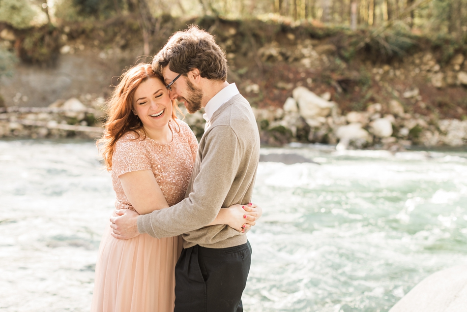 An engaged couple embraces at a river during their Steven's Pass engagement shoot for their dreamy DIY wedding at Dairyland in Snohomish, a wedding venue near Seattle. | Joanna Monger Photography | Snohomish & Seattle Photographer