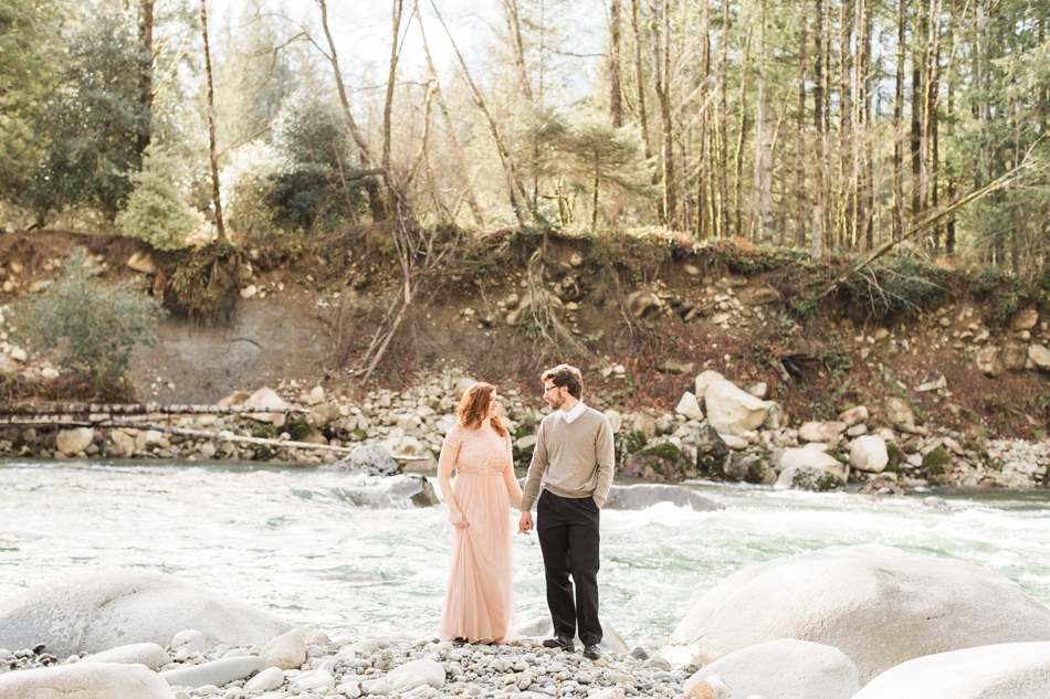 An engaged couple holds hands while looking at each other during their Steven's Pass engagement shoot for their dreamy DIY wedding at Dairyland in Snohomish, a wedding venue near Seattle. | Joanna Monger Photography | Snohomish & Seattle Photographer