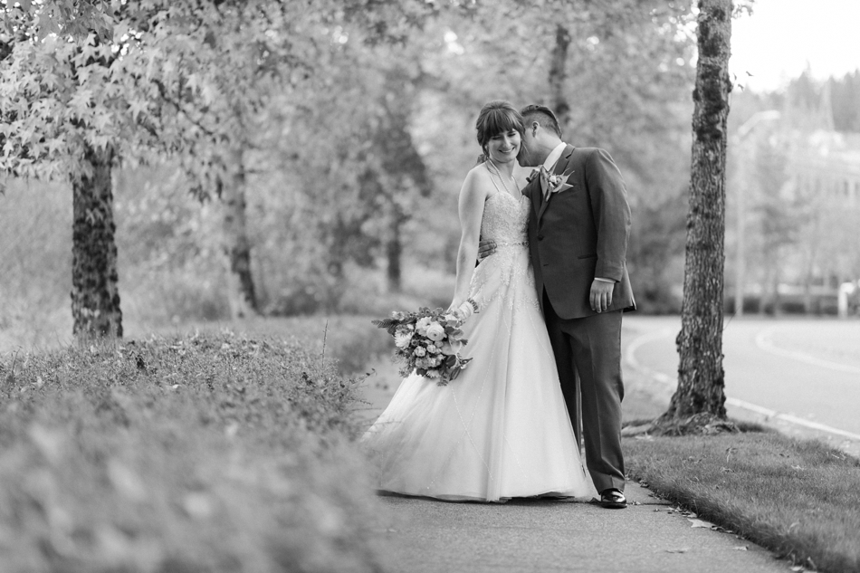 A black and white photo of a bride and groom before their fall wedding at the Loft at Russell's in Bothell, a wedding venue near Seattle. | Joanna Monger Photography | Snohomish & Seattle Wedding Photographer