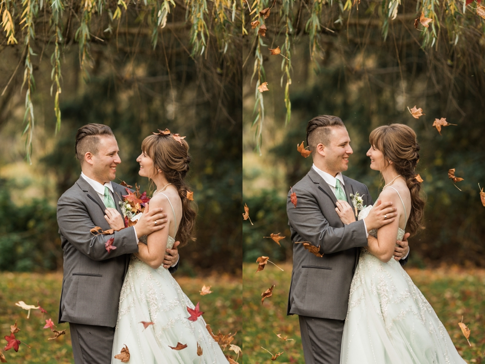 A photo of a bride and groom embracing while autumn leaves fall around them before their fall wedding at the Loft at Russell's in Bothell, a wedding venue near Seattle. | Joanna Monger Photography | Snohomish & Seattle Wedding Photographer
