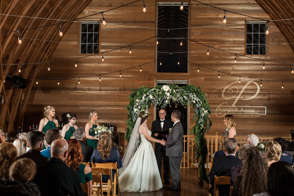 A photo of a bride and groom during their ceremony at their fall wedding at the Loft at Russell's in Bothell, a wedding venue near Seattle. | Joanna Monger Photography | Snohomish & Seattle Wedding Photographer