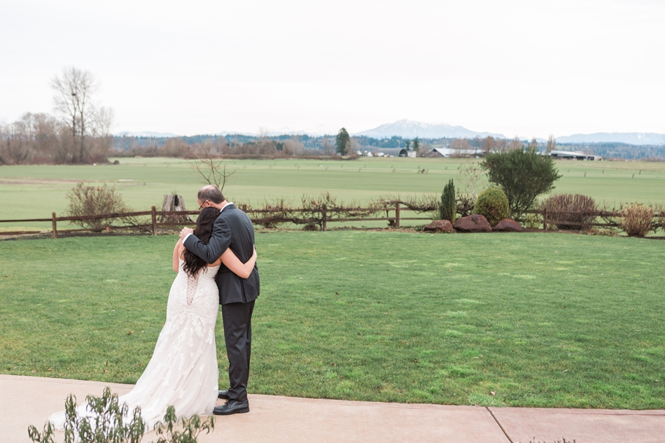 A father embraces his daughter after a first look before a winter wedding at Hidden Meadows in Snohomish, a wedding venue near Seattle, WA. | Joanna Monger Photography | Snohomish & Seattle Wedding Photographer