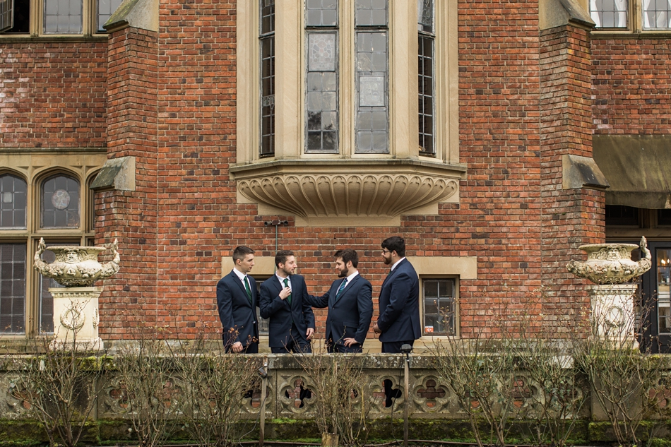 A groom talks with his groomsmen before his regal winter wedding at Thornewood Castle in Lakewood, a wedding venue near Seattle, WA. | Joanna Monger Photography | Seattle & Snohomish Wedding Photographer