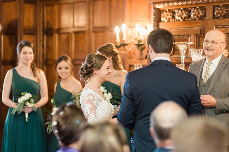Photo of a ceremony from a regal winter wedding at Thornewood Castle in Lakewood, a wedding venue near Seattle, WA. | Joanna Monger Photography | Seattle & Snohomish Wedding Photographer