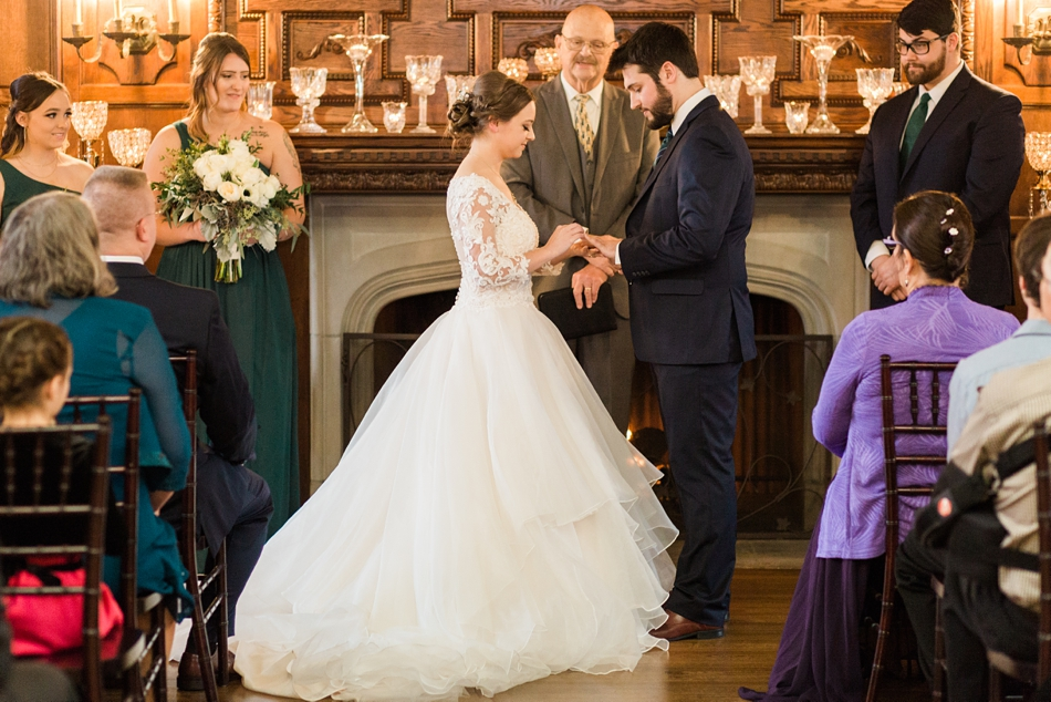 Photo of the ceremony from a regal winter wedding at Thornewood Castle in Lakewood, a wedding venue near Seattle, WA. | Joanna Monger Photography | Seattle & Snohomish Wedding Photographer