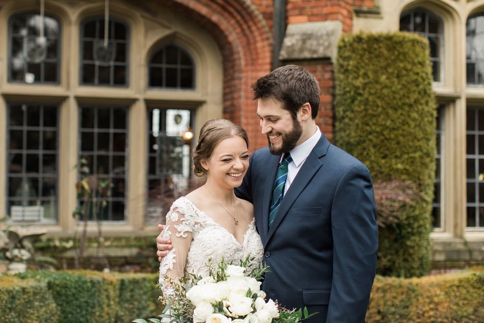 A bride and groom embrace and laugh after their regal winter wedding at Thornewood Castle in Lakewood, a wedding venue near Seattle, WA. | Joanna Monger Photography | Seattle & Snohomish Wedding Photographer