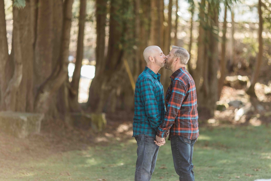 An engaged couple kisses in a forest during their spring outdoor mountain engagement shoot in Snohomish, near Seattle, WA. | Joanna Monger Photography | Snohomish Wedding Photographer