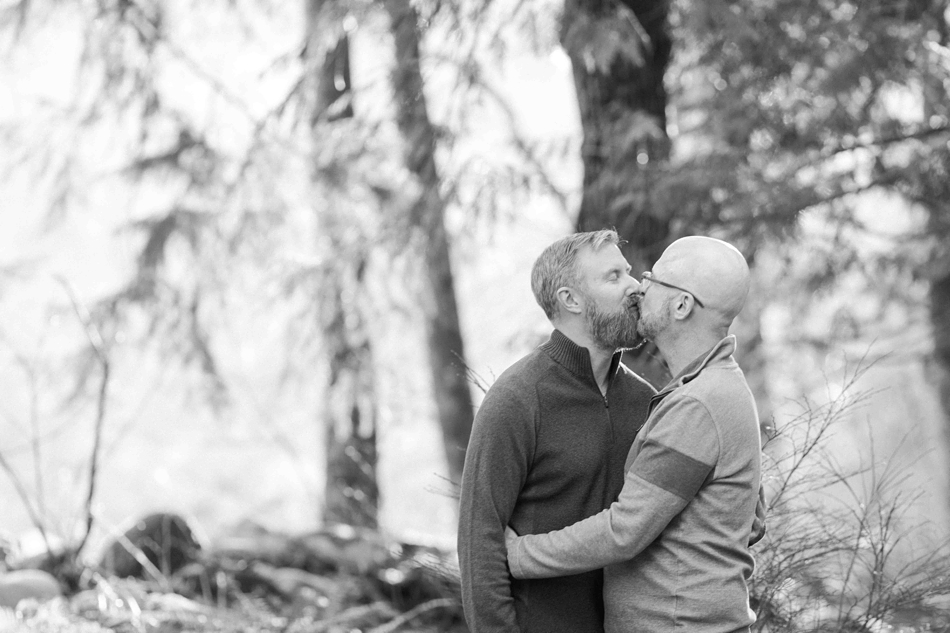 A black and white photo of an engaged couple kissing during their spring outdoor mountain engagement shoot in Snohomish, near Seattle, WA. | Joanna Monger Photography | Snohomish Wedding Photographer