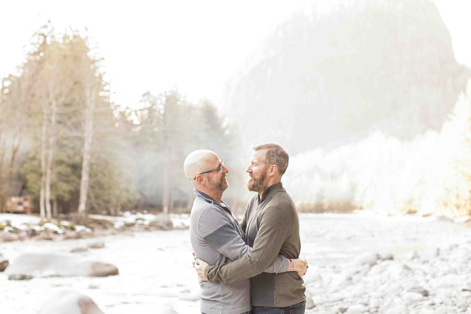 Photo of an engaged couple by a river during their spring outdoor mountain engagement shoot in Snohomish, near Seattle, WA. | Joanna Monger Photography | Snohomish Wedding Photographer