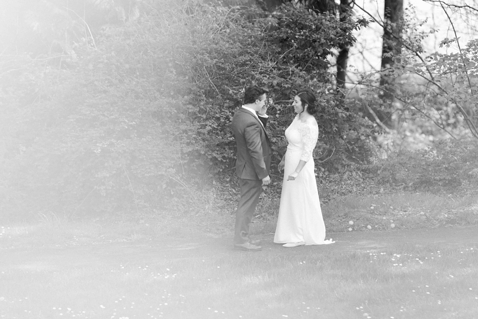 Photo of a couple during their first look before their intimate wedding at Belle Chapel in Snohomish, a wedding venue near Seattle, WA.   Joanna Monger Photography   Snohomish Wedding Photographer