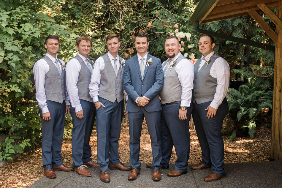 Groomsmen and groom at Twin Willow Gardens in Snohomish. Photographs by Joanna Monger Photography, Award Winning Snohomish Wedding Photographer.
