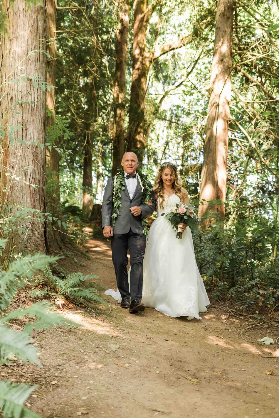 Walking through trees at Twin Willow Gardens in Snohomish. Photos by Joanna Monger Photography, Snohomish and Seattle Wedding Photographer.