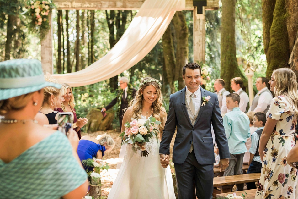 The bride and groom walk the aisle at Twin Willow Gardens in Snohomish. Photos by Joanna Monger Photography, Snohomish and Seattle Wedding Photographer.