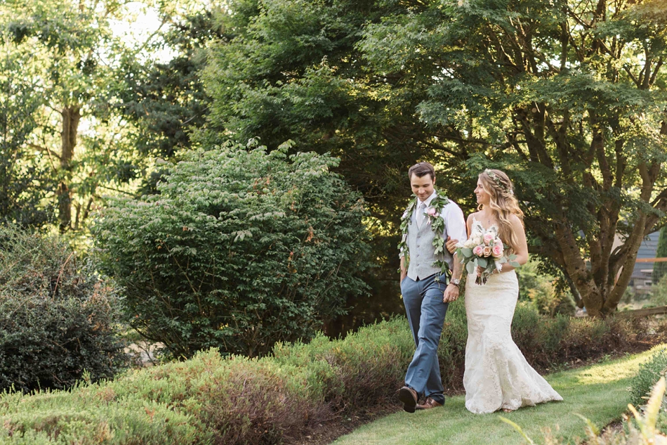 Bride and groom walking together at Twin Willow Gardens in Snohomish. Photos by Joanna Monger Photography, Snohomish and Woodinville Wedding Photographer.