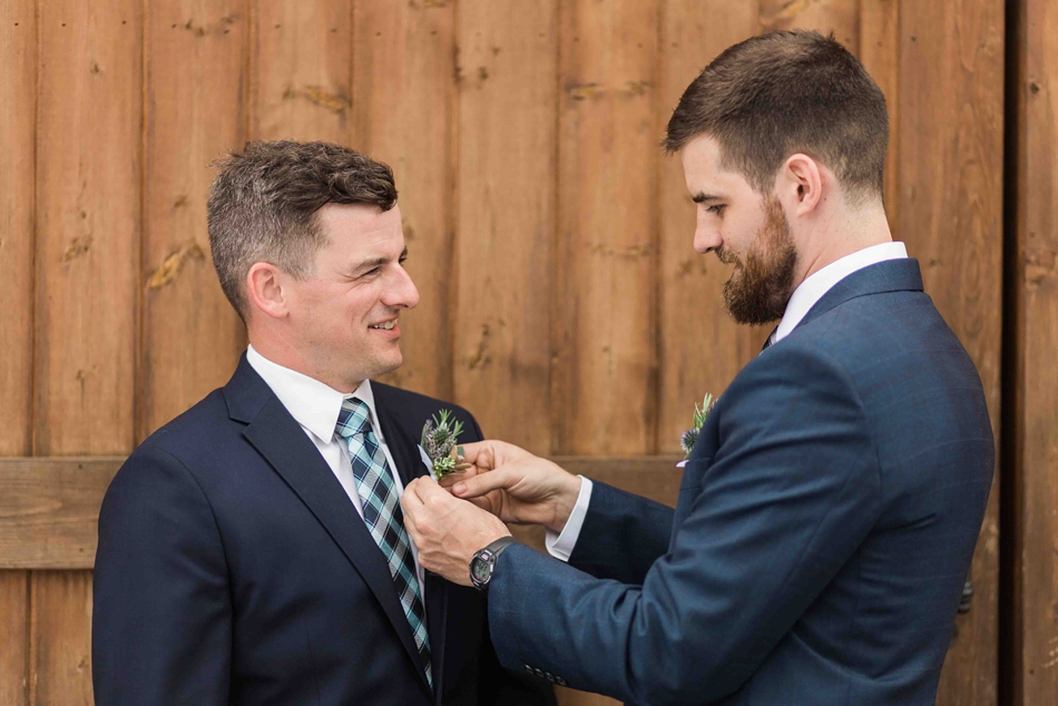 Making adjustments at Pine Creek Nursery in Monroe. Photos by Joanna Monger Photography, Snohomish and Woodinville Wedding Photographer.