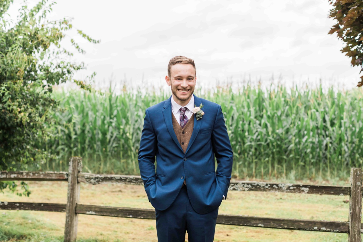 Groom laughing at Craven Farms in Snohomish. Photographs by Joanna Monger Photography, Snohomish's Best Wedding Photographer.