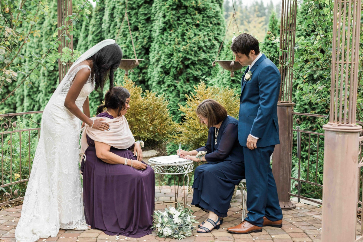 Signing at Green Gates at Flowing Lake. Photographs by Joanna Monger Photography, Snohomish's Best Wedding Photographer.