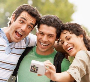 Friends Taking Picture of Themselves --- Image by © Royalty-Free/Corbis