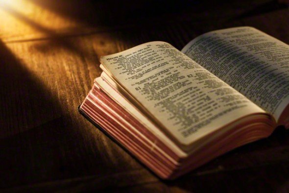 Close up of open Bible on table