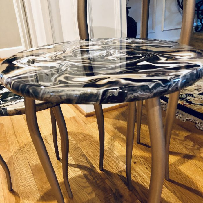 acrylic paint pour with resin on table top.