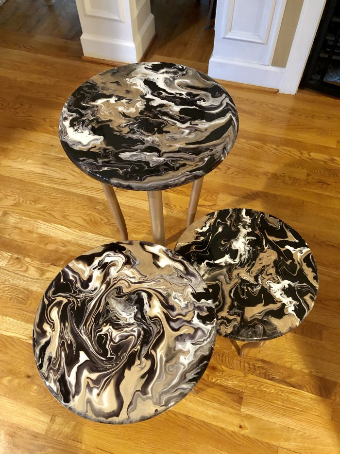 acrylic paint pour on tables.