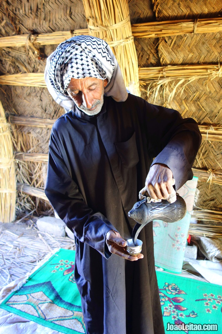 Man serving coffee inside his home