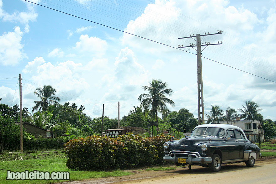 Black car by the side of the road in Cuba