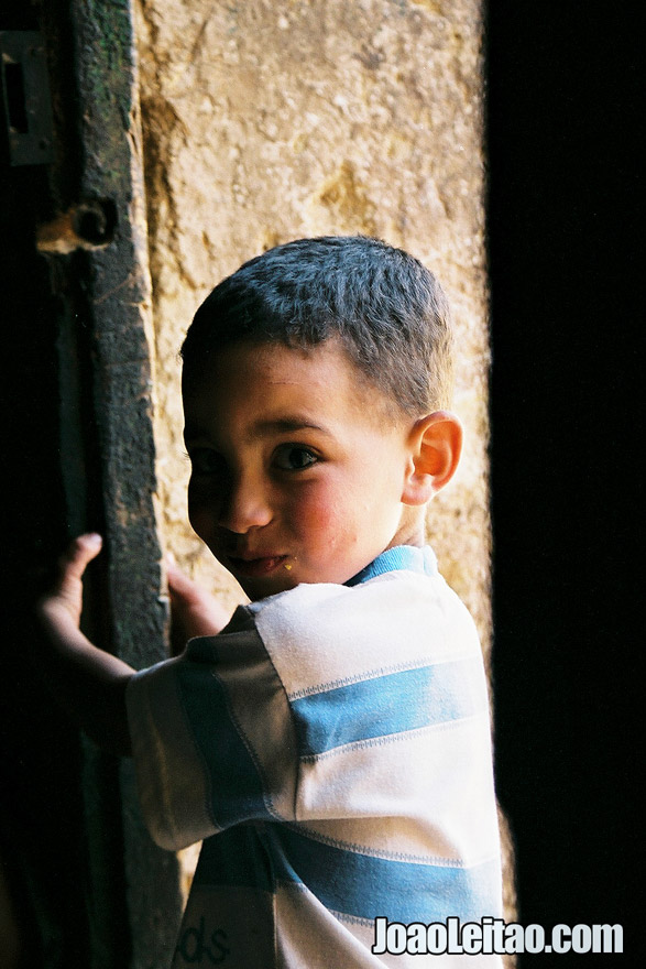 Photo of little boy waiting at the door, Morocco