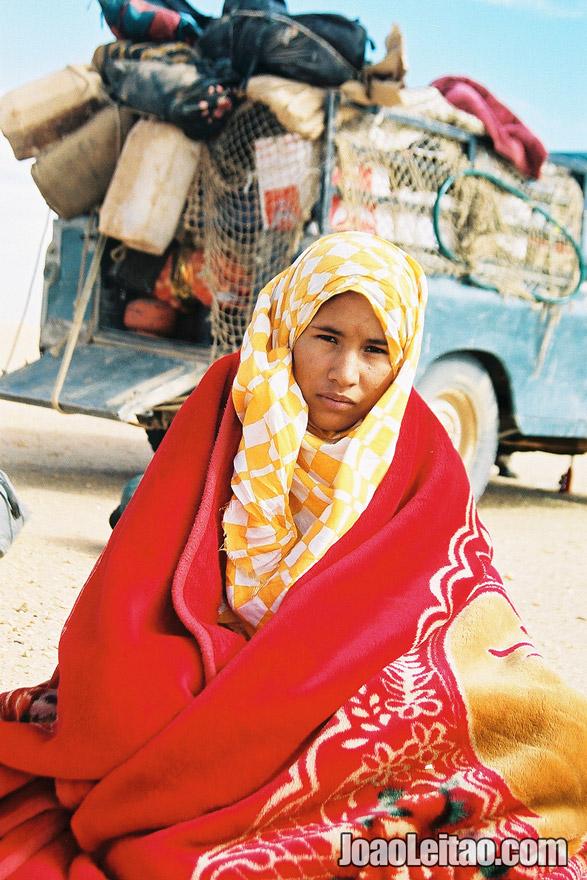 Photo of Girl in Sahara Desert tracks of Sebkhet Oum way to Bir Moghrein,  Mauritania