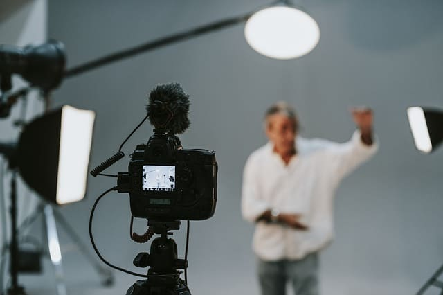 Person doing acting front of camera.
