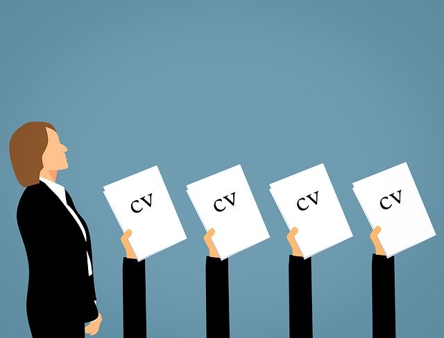 candidate are waiting holding CV for their interview.