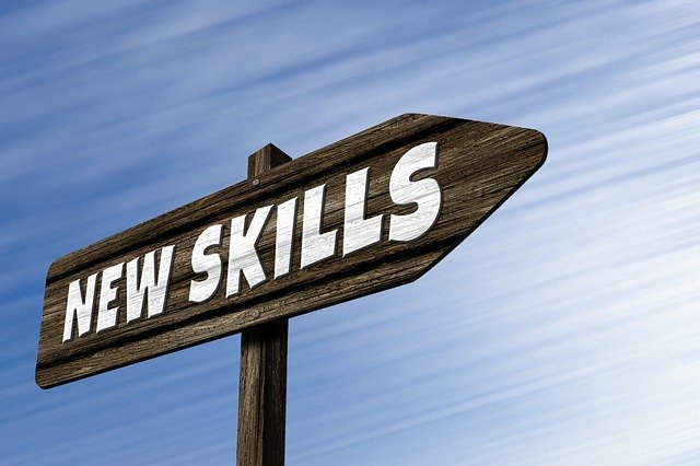 Board of new skills sign for workplace success.