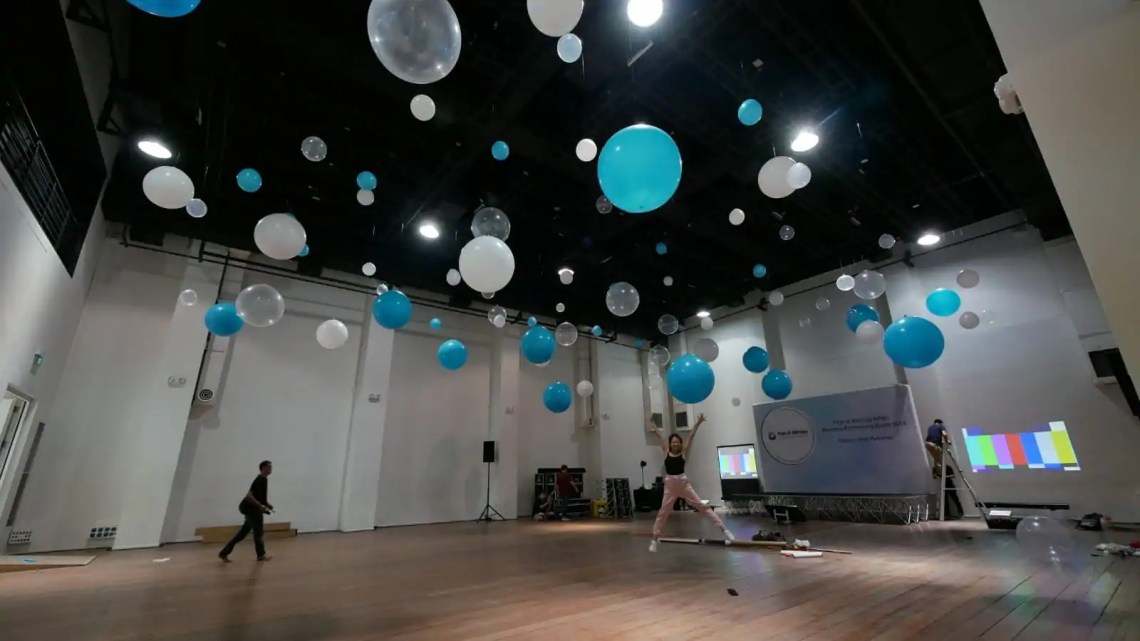 Sparse hanging balloon ceiling decorations