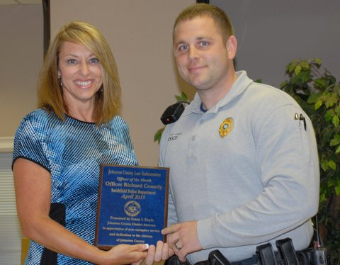 (Left to Right) Johnston County District Attorney Susan Doyle presents the April Law Enforcement Officer of the Month Award to Smithfield Police Officer Ricky Conerly.