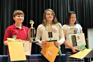 Winners of the JCS Elementary Spelling Bee. Pictured, left, 3rd place winner, Jacob Ellis (Four Oaks Elementary); 1st place winner, Ariana Arbelaez (Cooper Elementary); and 2nd place winner Whitley McCoy (Princeton Elementary). 