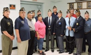 "Pictured from left to right are: 1st Vice Commander Eugene ""Beanie"" Eckerson. Sgt-at-arms Ken Stith & Larry Tice, Post Service Officer Deloy Shaw, Finance Officer Cynthia Shaw, Judge Advocate Percy Liles, Chaplain Joe Hester, 2nd Vice commander David ""Slammer"" Sammons (rear), Adjutant Ken Parker, Past commander Rudolph Allen, Post Historian Gene Karaszewski (rear), Post-71 Commander Devell ""Bull"" Durham and Post Building and grounds officer Ken Wendel."