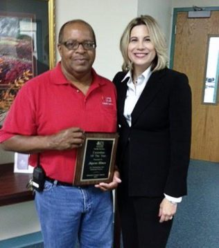 Jaycee Hines (left), head custodian at Riverwood Elementary School, is the 2015 JCS Custodian of the Year. Standing with him is Principal Dorlisa Johnson-Cowart.