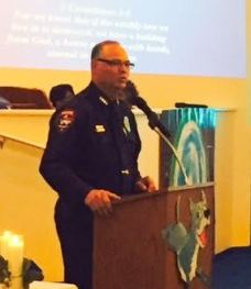 Smithfield Police Chief Michael Scott speaks during a Prayer Vigil Service Tuesday at St. Peter Church of Christ to remember the victims of the Charleston, SC church shooting.