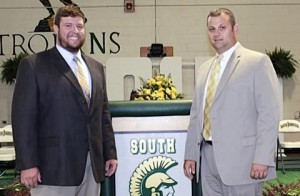 Pictured: (Left to right) South Johnston High football coach Hunter Jenks is congratulated after being named the school's new athletic director by incoming Principal David Pearce.