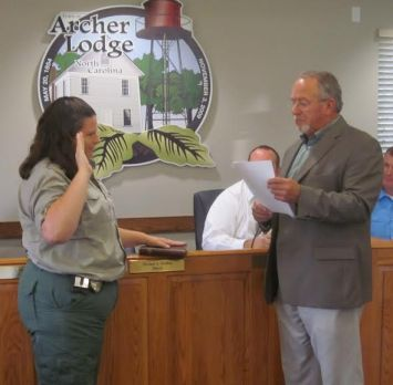 (Left to right) Clayton Animal Control Officer Angela Lee is sworn in as animal control officer in Archer Lodge by Mayor Mike Gordon.