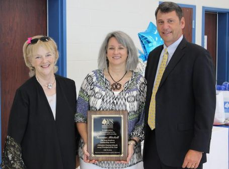 Selma Elementary School's Suzanne Mitchell (center) is the 2015-2016 Wells Fargo Principal of the Year for Johnston County Schools. Standing beside her is Johnston County Board of Education member Dr. Peggy Smith (left) and Superintendent Dr. Ed Croom (right).