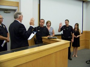 Mayor John Lampe (left) administered the new oaths to Officers Brian O'Branovich (center) and David Johnson (right) on Tuesday night.