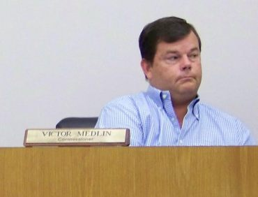 Four Oaks Commissioner Vic Medlin listens to testimony during a solar farm public hearing Monday night. WTSB Photo