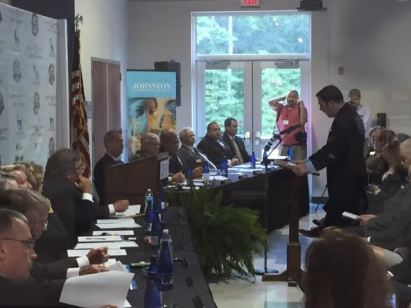 Johnston County Economic Development Director Chris Johnson addresses the Johnston County Board of Commissioners and members of the Clayton Town Council. Photo by John Payne