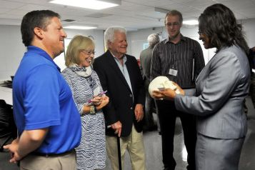 Dr. Katherine Stevenson-Chavis, lead engineering instructor, shows Lyn Austin, JCC trustee chair, and community members a skull prototype created by the program's 3D printer.